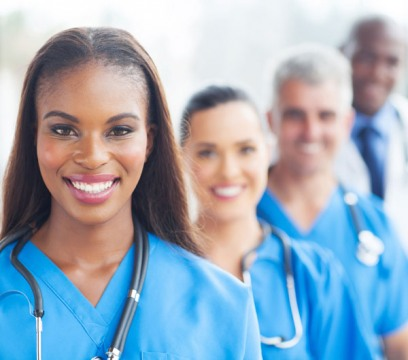 group of happy healthcare workers line up